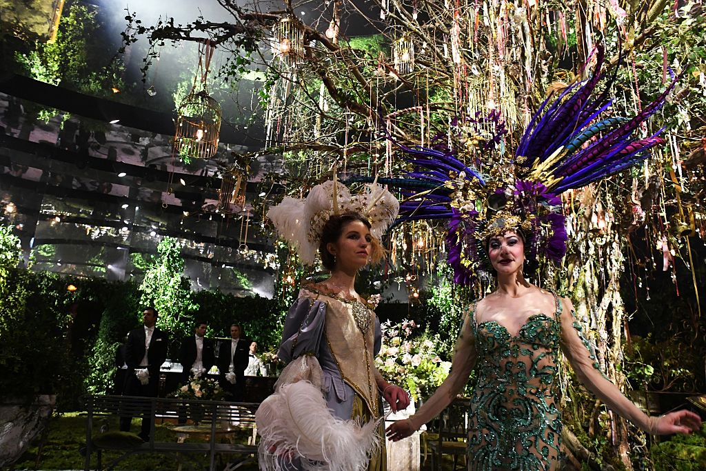 "People attend the ""Grand Bal Christian Dior"" event during the 2017 spring/summer Haute Couture collection on January 23, 2017 in Paris.  / AFP / ALAIN JOCARD        (Photo credit should read ALAIN JOCARD/AFP/Getty Images)"